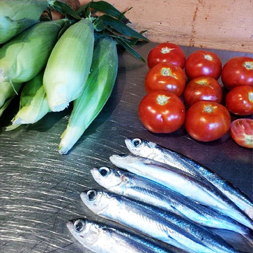 Fish, corn and tomatoes in the kitchen at Wasabi Ramen and Izakaya in Kelowna