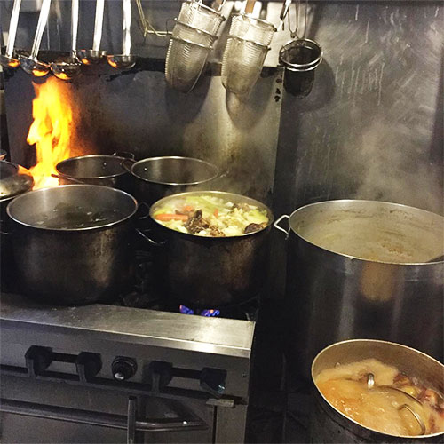 Stock pots boiling away at Wasabi Ramen and Izakaya in Kelowna